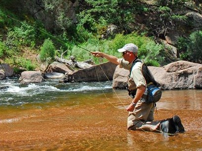 Pat Dorsey Casting a fly rod in a Colorado river