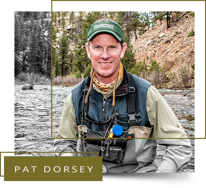 Pat Dorsey with river and mountainous background