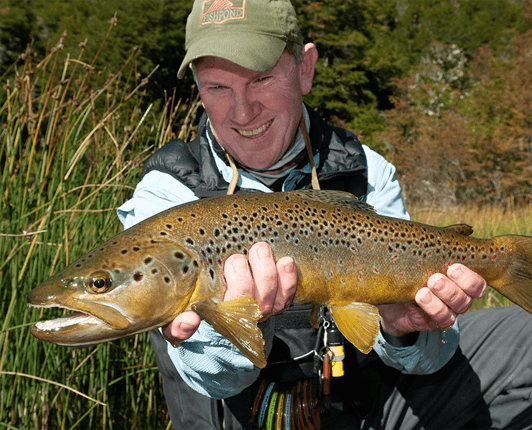 Pat Dorsey holding a brown trout